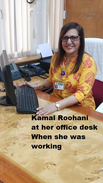 Kamal Roohani at her desk at work.